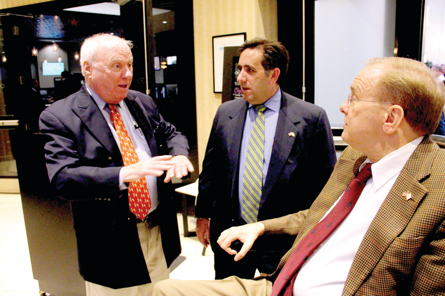TALKING POLITICS: Former Mayor Joseph Walsh expounds on the political scene with Seth Klaiman and Congressman Jim Langevin. Klaiman manages Langevin's Rhode Island office.