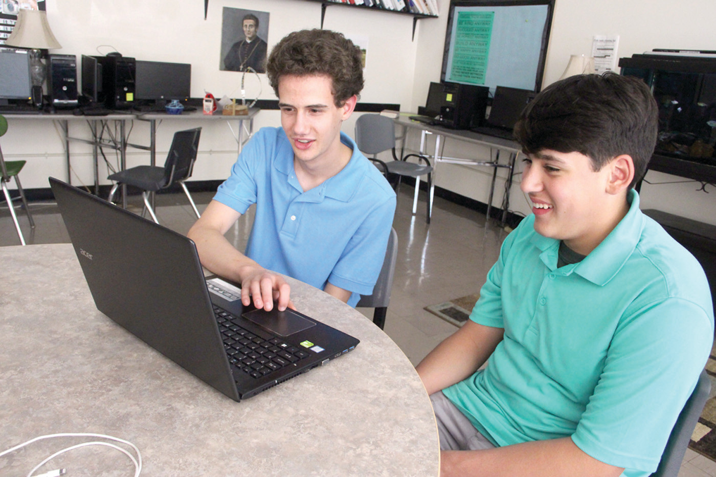 A HELPING HAND: Student mentor Mike Carlino works with RJ Robitaille on an assignment.