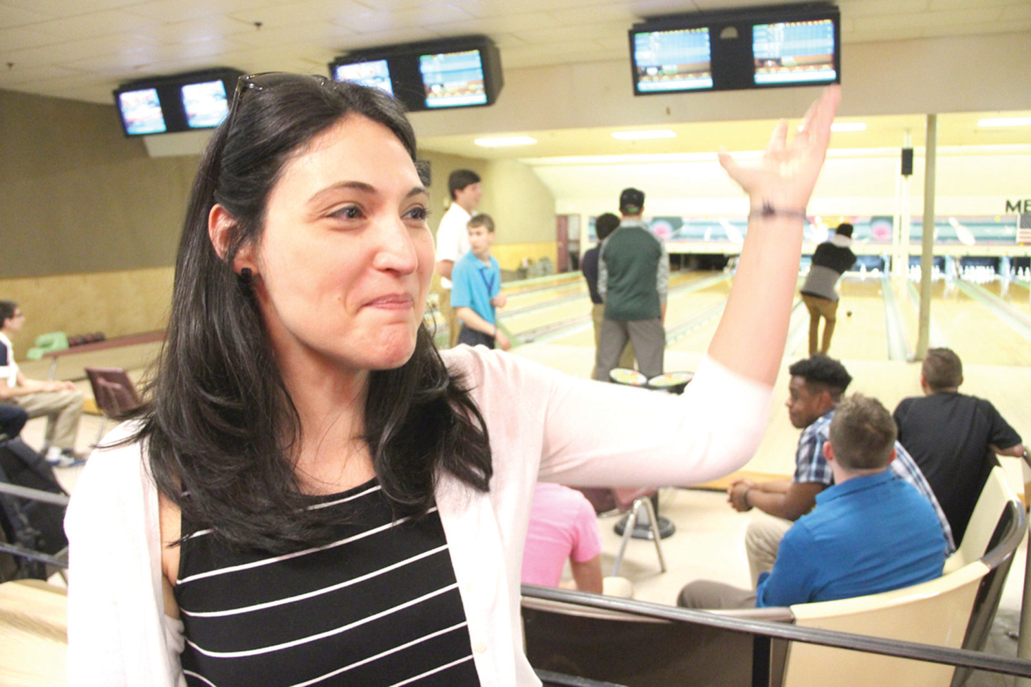 LOTS GOING ON: Options Program Director Natalie Kessimian takes a moment out of an end of the year bowling party for students to explain the program.