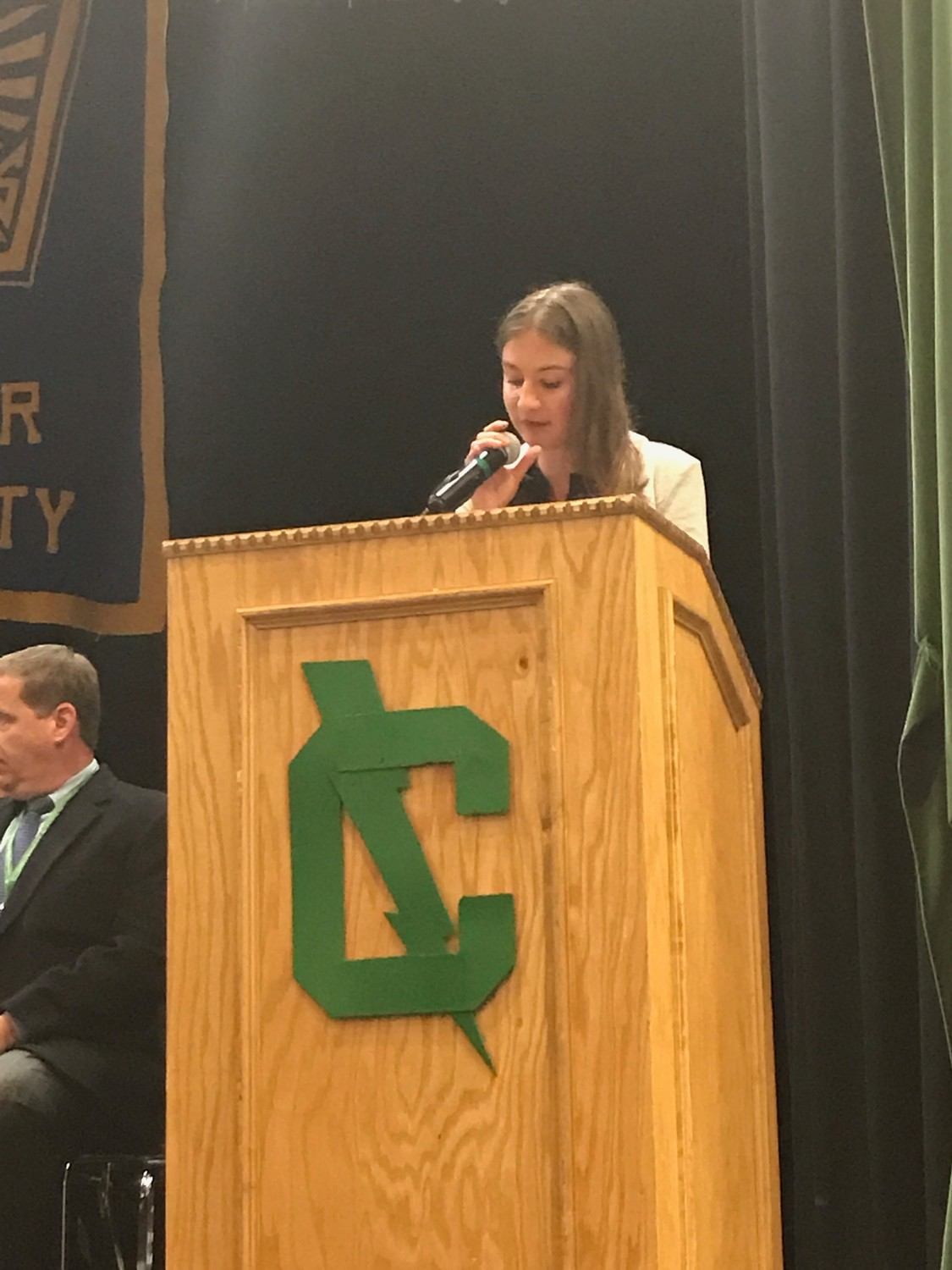 TOP HONORS: National Honor Society president Brenna Rojeck addresses the audience at the NHS induction ceremony on May 10.