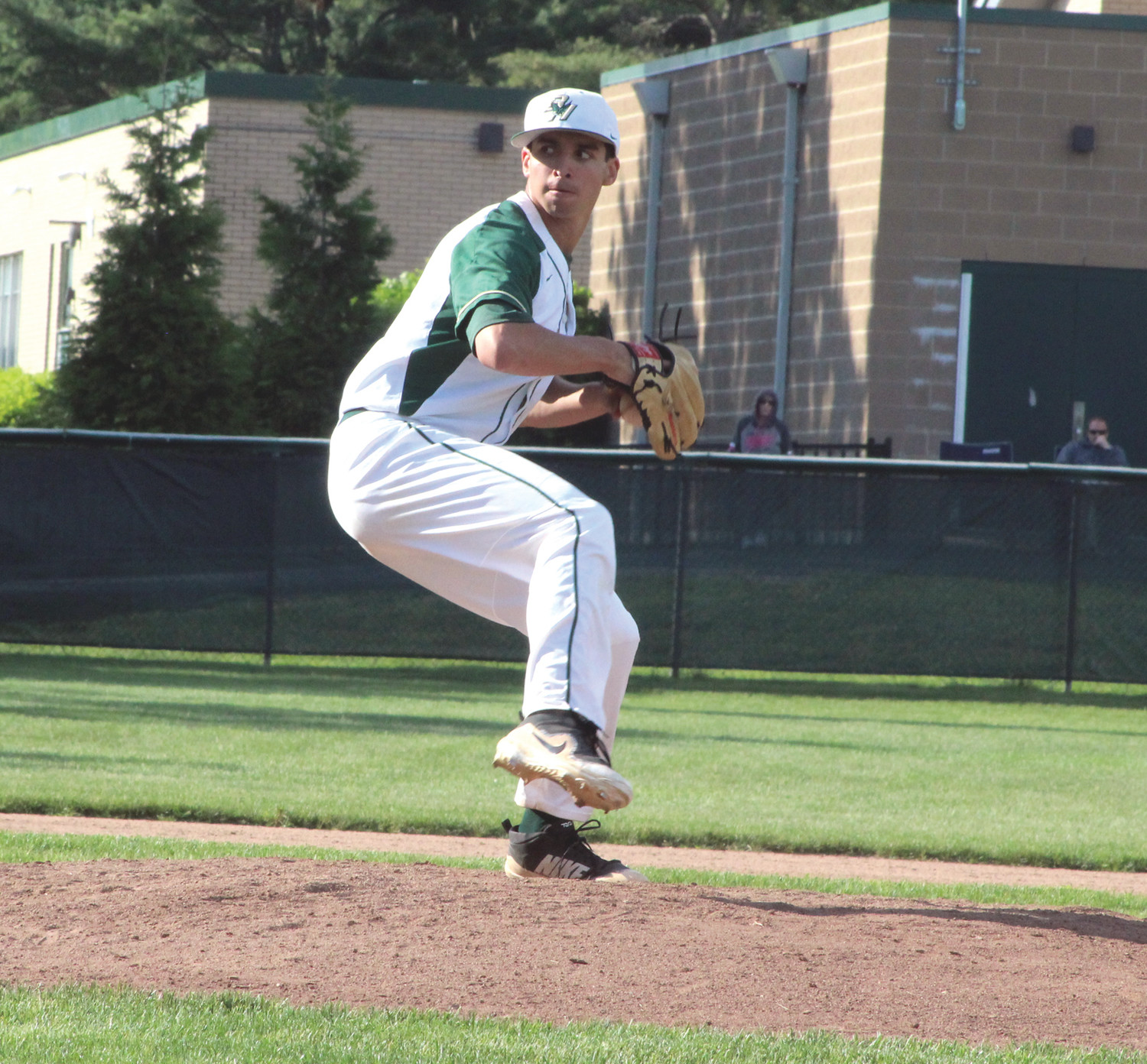 HEADING TO EXTRAS: Bishop Hendricken's Matt Smaldone delivers a pitch against East Providence.