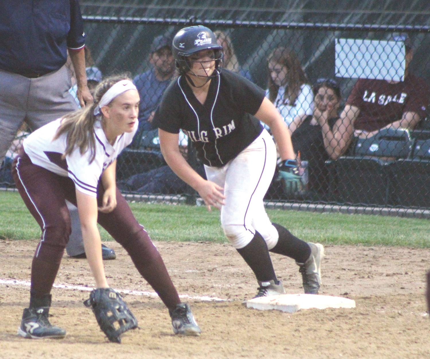 ON YOUR MARK: Pilgrim's Karly Evans (right) gets ready for the hit and run against La Salle in the D1 playoffs.