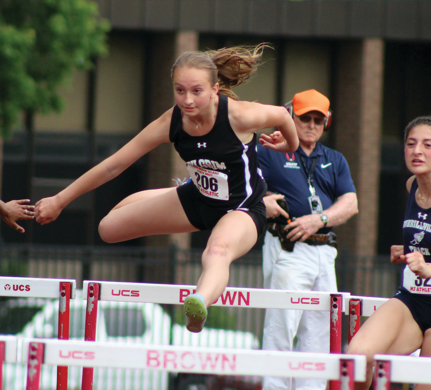 EYE ON THE PRIZE: Pilgrim's Anna Cetera competes in the hurdles on Saturday at Brown Stadium.