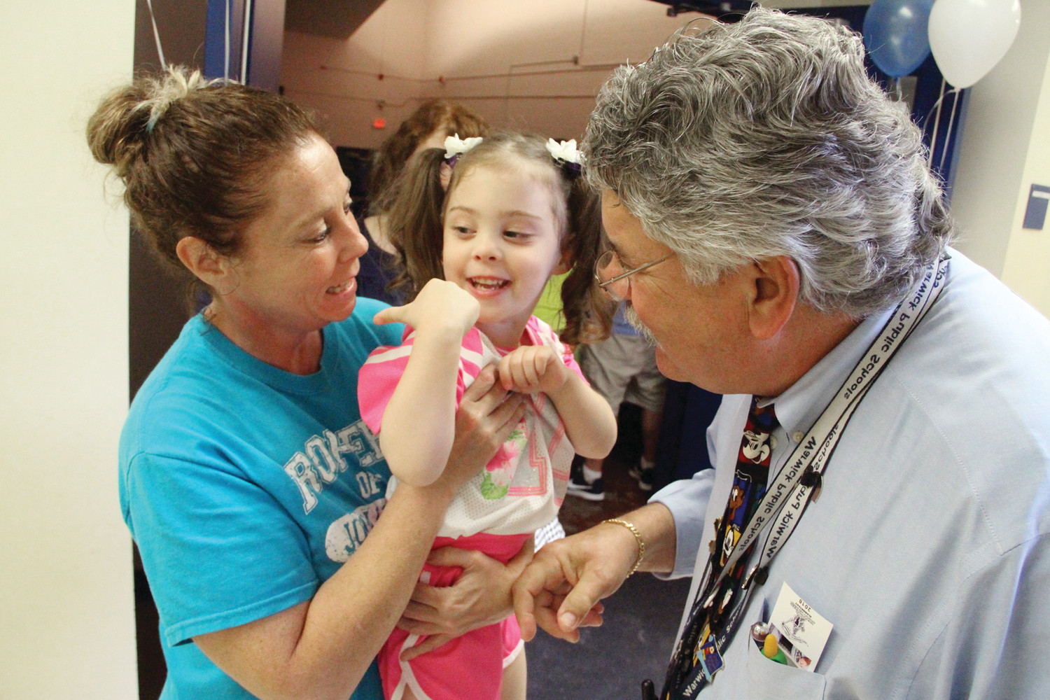 TOO YOUNG TO BE A WICKES STUDENT: Four-year old Skylah Lemoi and her aunt Kerry talk with Wickes Principal Roy Costa at Friday's open house.