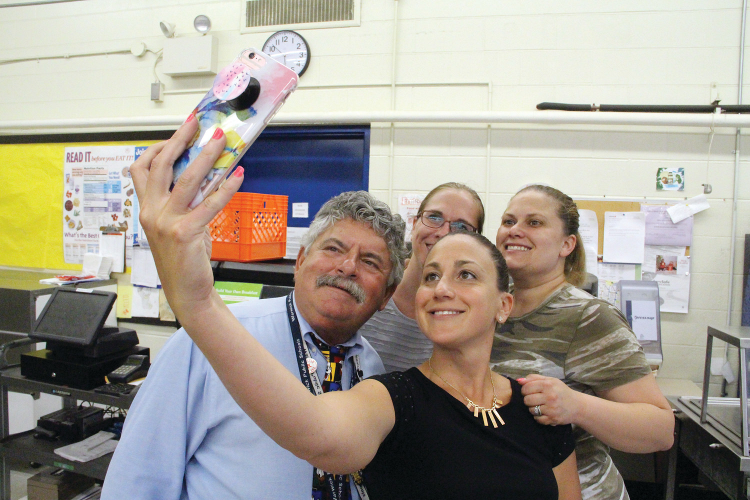 PRINCIPAL SELFIE: Christina Gianfrancesco snaps a selfie with Principal Costa and Brandy Pezza and Nikki Carpenter. All members of the PTO, the three women helped plan and run Friday's event.