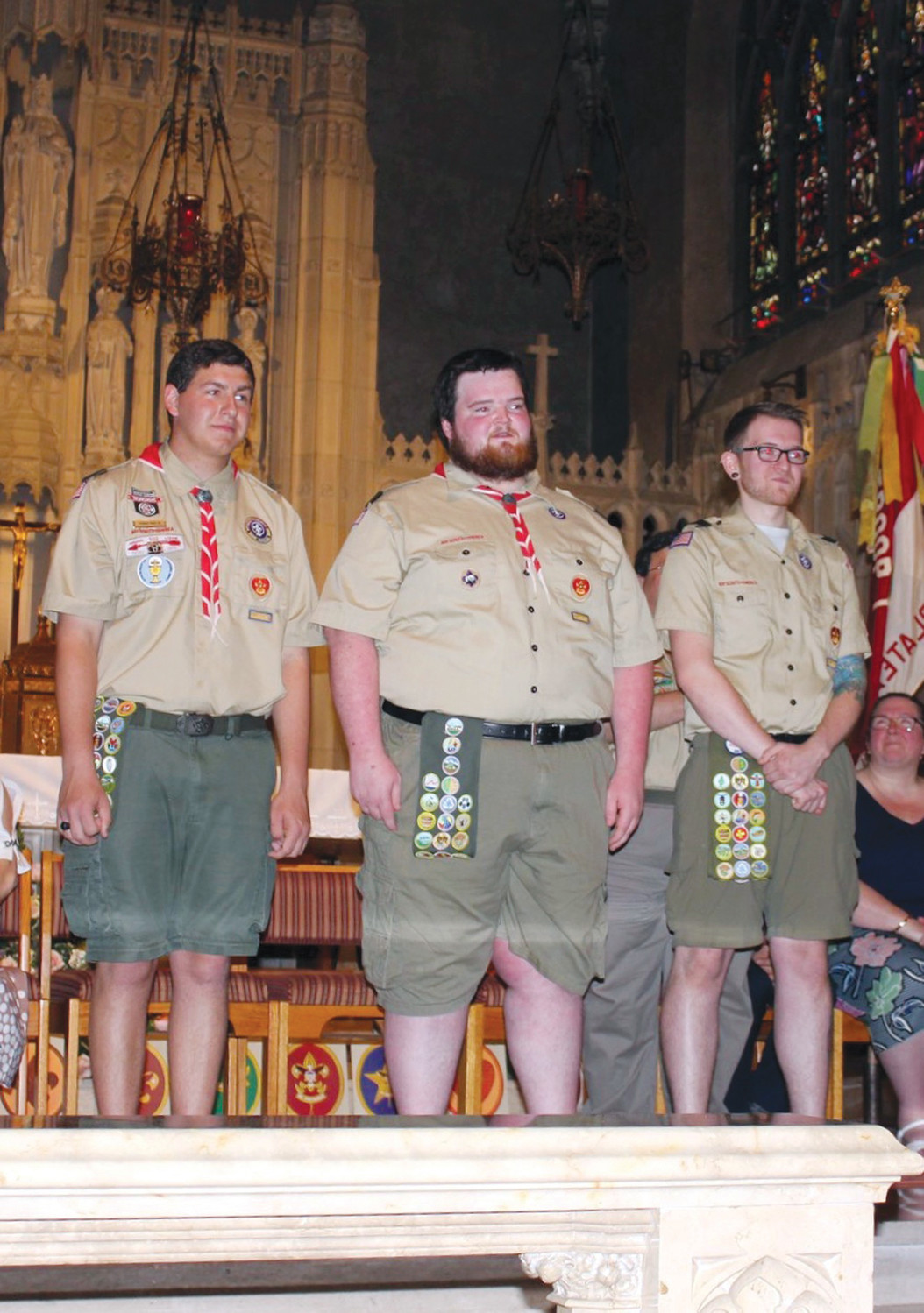 THE HONORED: Thomas Yakey Jr., Michael Stubbs, and James Stubbs stand on stage while receiving their Eagle Scout honors last week.
