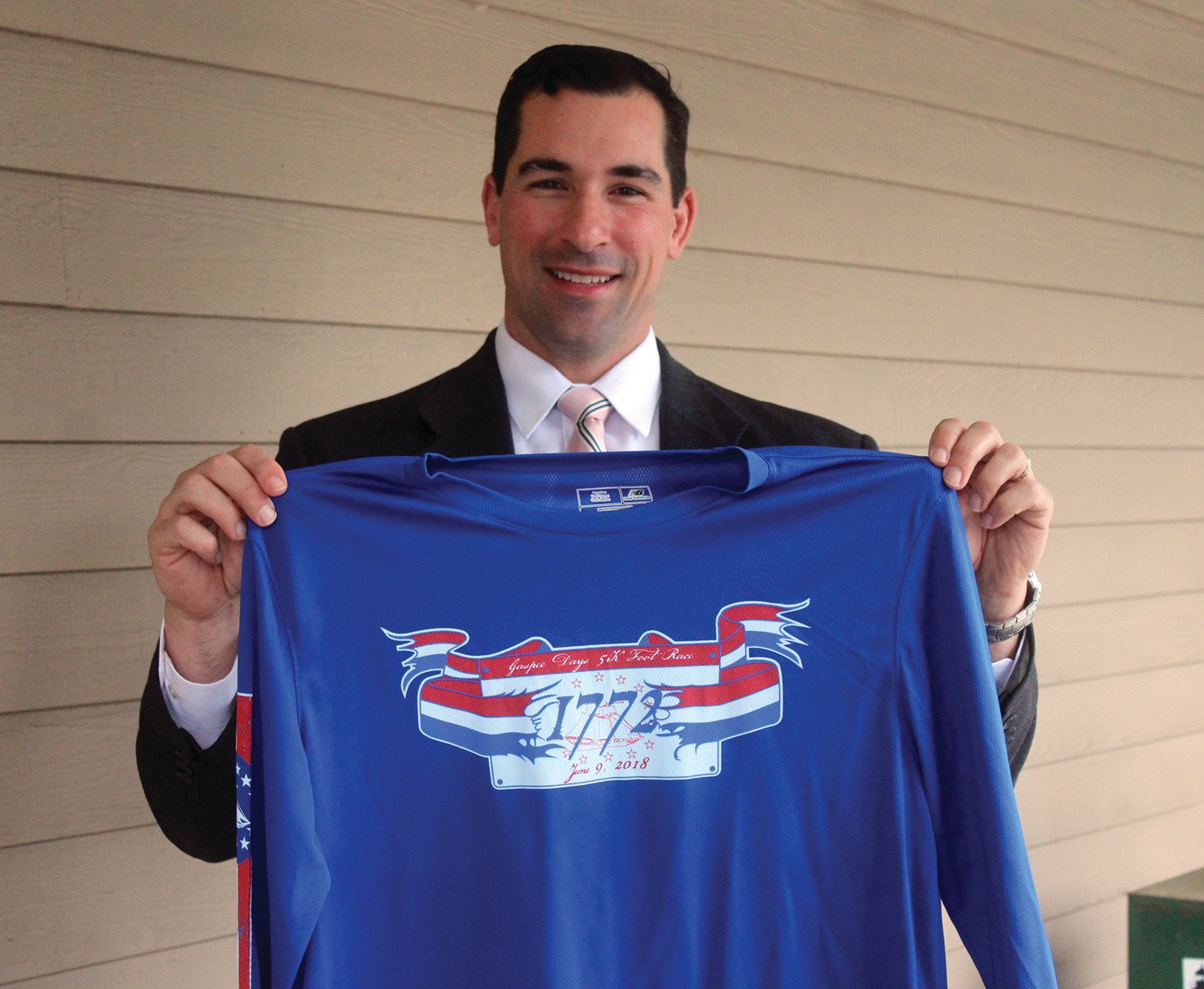 ON YOUR MARK: Chairman Matthew Tsimikas shows off a t-shirt for this year's race.