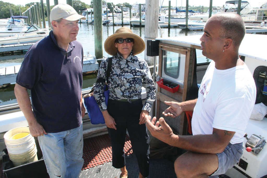 In 2014, Warwick quahogger Jody King gave Senator Sheldon Whitehouse and his wife, Sandra, a tour of the upper bay near Warwick Neck and a chance to try their hand at quahogging. The senator's office inquired about the opportunity to get close perspective of the shellfishing industry after reading about King and the Quahog Jamboree hosted by the Warwick Public Library earlier that year.
