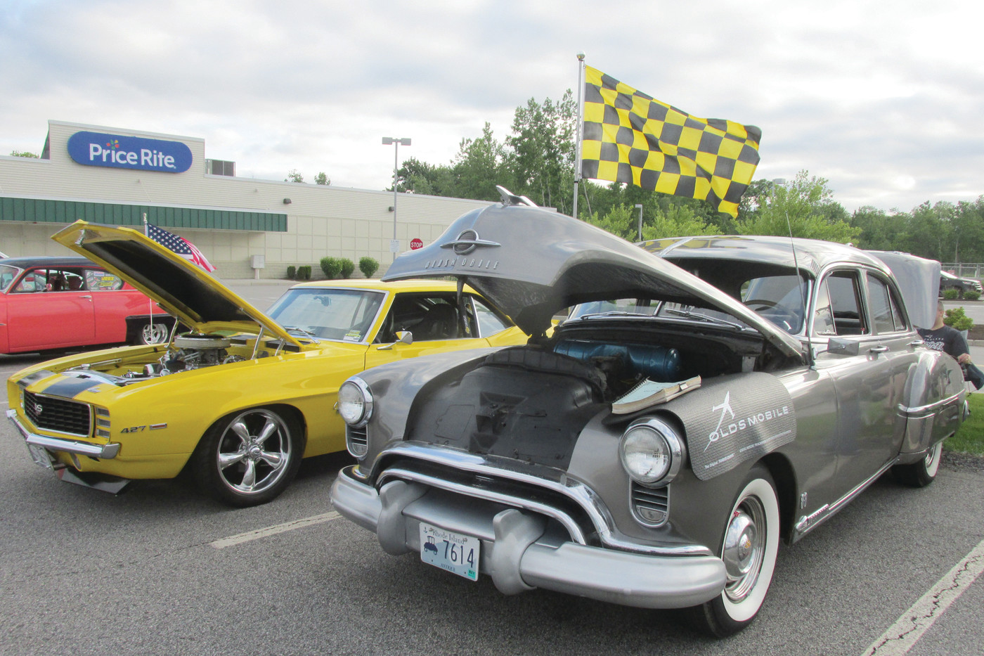 VINTAGE VEHICLES: This Daytona yellow 1969 Chevrolet Camaro SS (left) that's owned by Gary Maddocks and silver-gray 1949 Oldsmobile 88 that the pride of Johnston resident Alex Lucini were among the many classic cars on display during last Thursday's Cruizin' for a Cause. (Sun Rise photos by Pete Fontaine)
