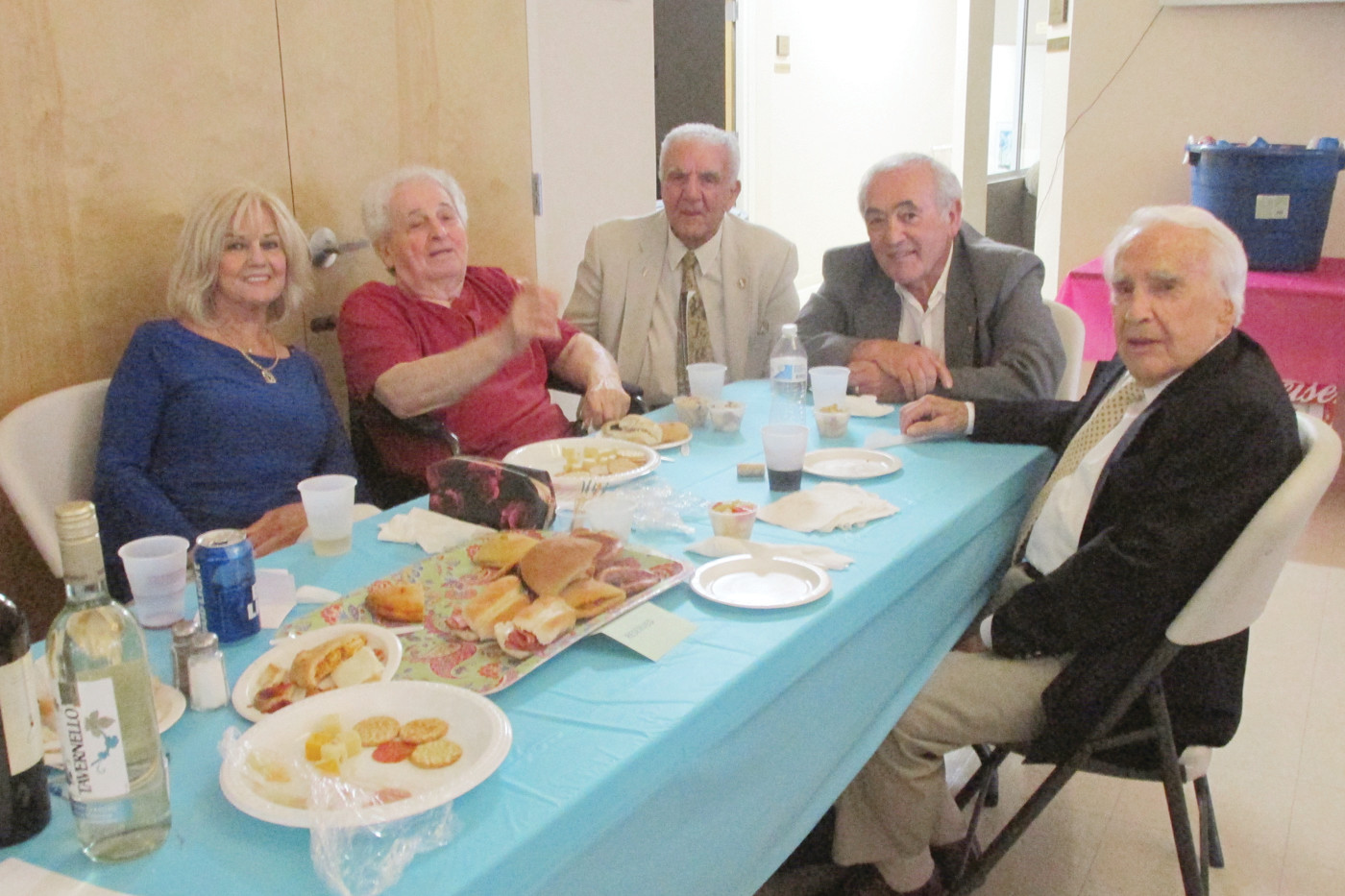 "CHAIR'S CORNER: JSC Advisory board Chairman Peter Lombardi (center) sits with his friends at a table that was filled with a variety of food and beverages all of which were donated especially for Saturday's sold out ""Tribute to Frankie Valli."""