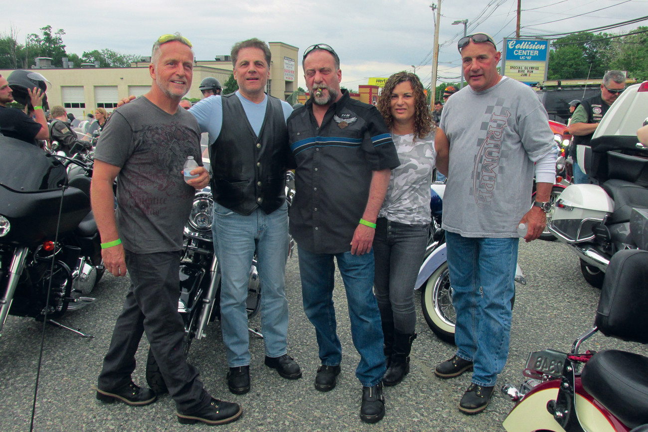 TOM'S TROOP: Tom Lonardo (center), who designed the Marian J. Mohr Memorial Library, and his friends Henry Pitchotte, Ralph D'Ambruoso, Robin and Bill Forte and Rich DiFusco were among the many motorcyclists who participated in Saturday's SORI Run.