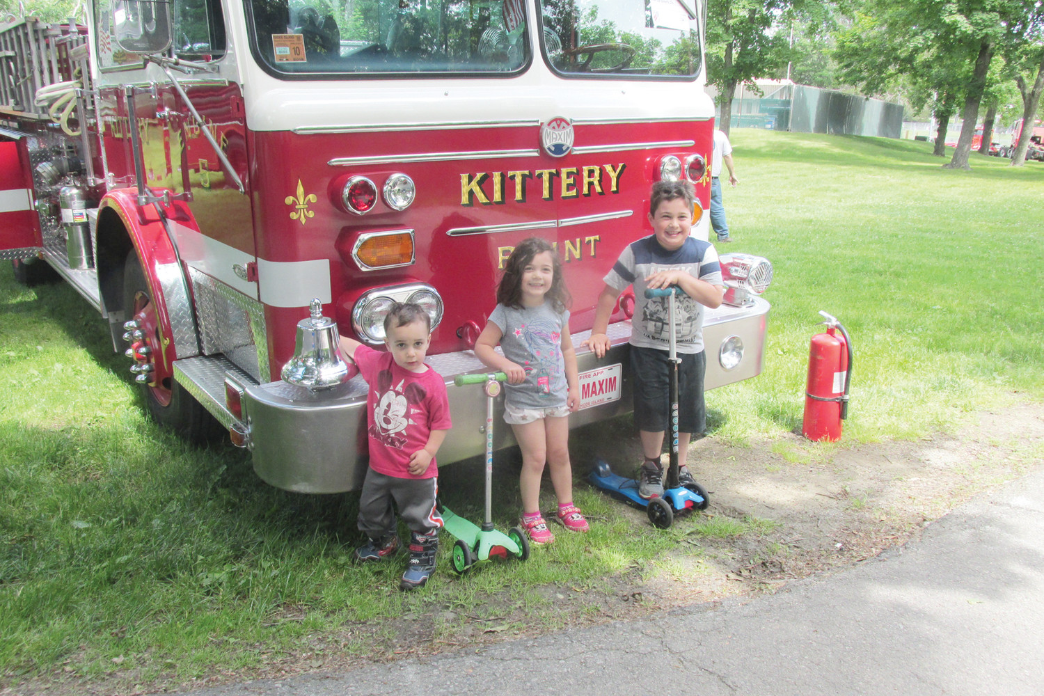 KID'S KORNER: The Thomas children – Elliot, 2; Marina, 4, and Harrison, 6 were among the many children that had their pictures taken Sunday beside one-time city and town operated fire trucks that are now the property of private owners/collectors. (Sun Rise photos by Pete Fontaine)