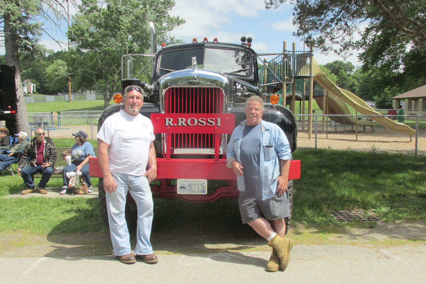 OUTSTANDING OFFICIALS: Johnston's Joe Pingitore (left) and Cranston's Ron Rossi enjoy a lighter moment during Sunday's free to the public Ocean State Vintage Haulers show that lined War Memorial Park with a variety of different make and model trucks.