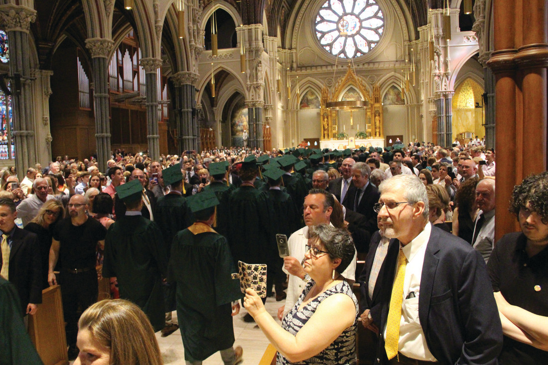 GRADUATION SETTING: The Cathedral of Saints Peter and Paul was filled with admiring family as the graduates filed in for commencement exercises Friday evening.
