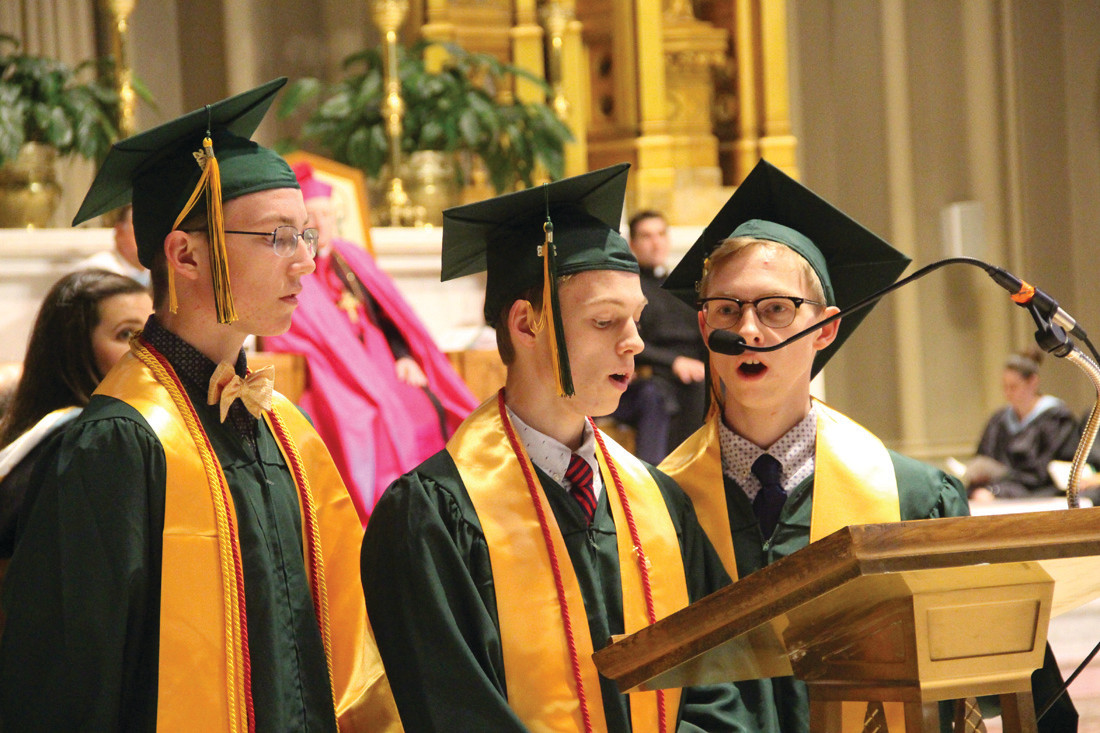 "MUSICAL INTERLUDE: Graduating seniors rejoined the chorus to sing ""I Will Rise,"" an interlude during the program."