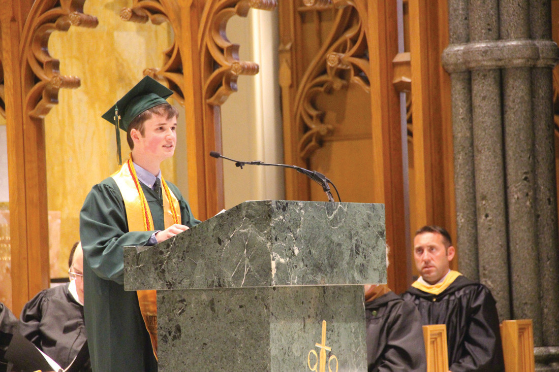 ADDRESSING HIS CLASSMATES: Dylan Temel, class valedictorian, delivers his commencement address.