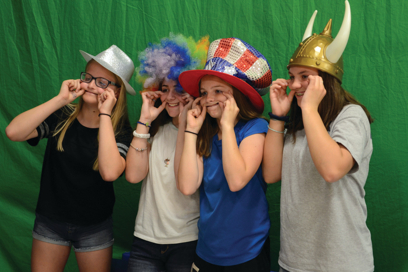GROUP GOALS: From left to right – Carly Gayman, Madison Giarrusso, Kiley Strain and Hanna Carter enjoyed taking a goofy shot at the photo booth together.