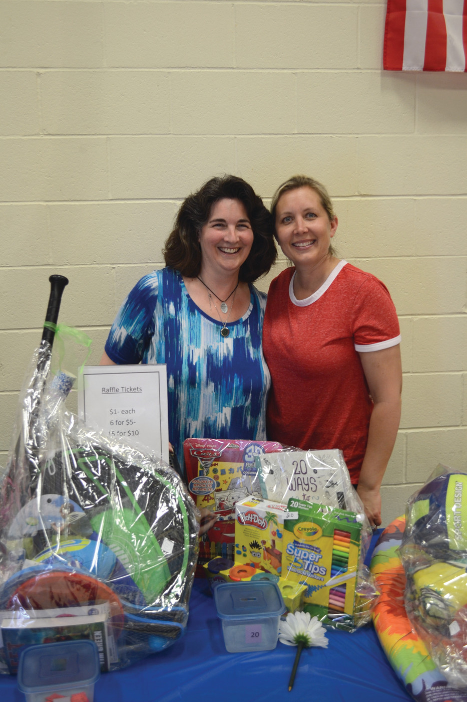 LEADING LADIES: John Brown Francis PTA co-presidents Liz Gambuto and Carla Cote staffed the large raffle at the farewell event.