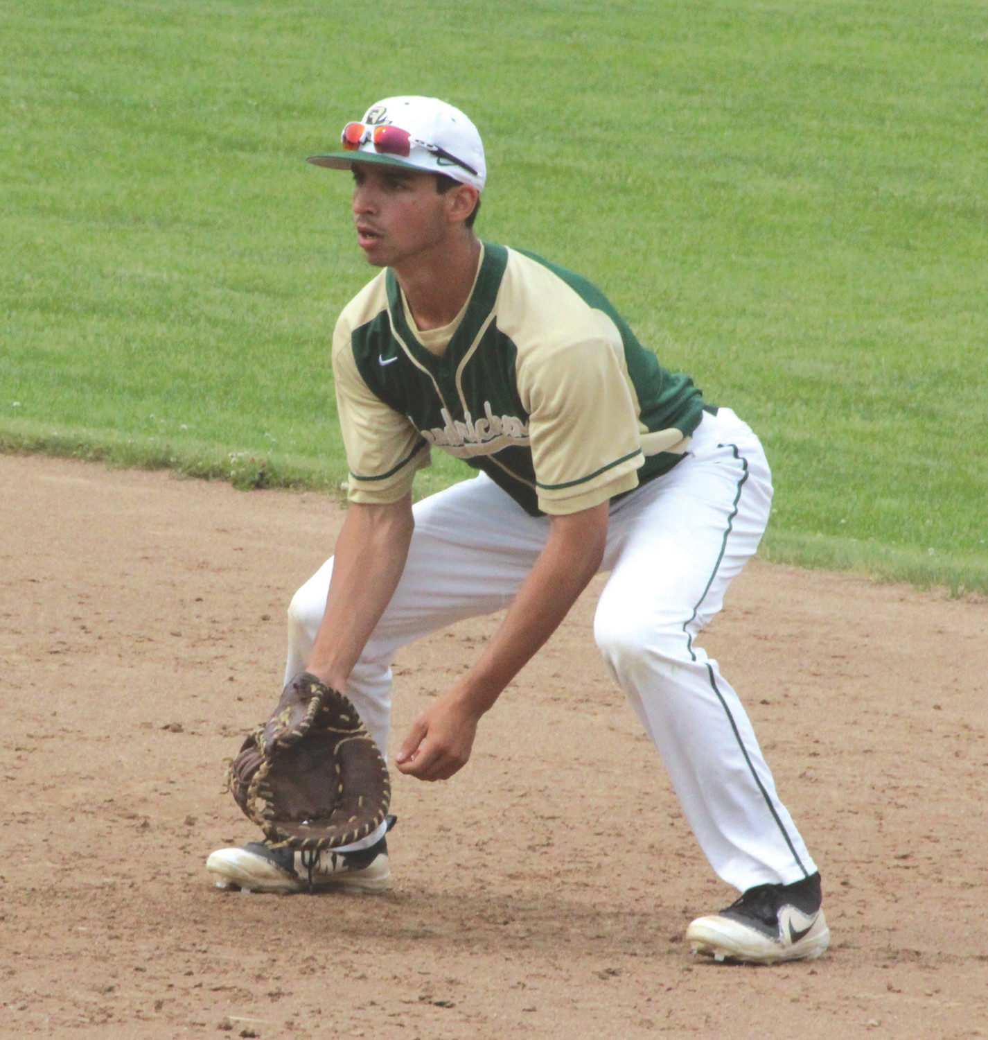 PLAYING THE FIELD: Bishop Hendricken's Matt Smaldone prepares to field a ground ball at first base against Conventry on Saturday afternoon at McCoy Stadium during the Division I Pod 1 regional final.