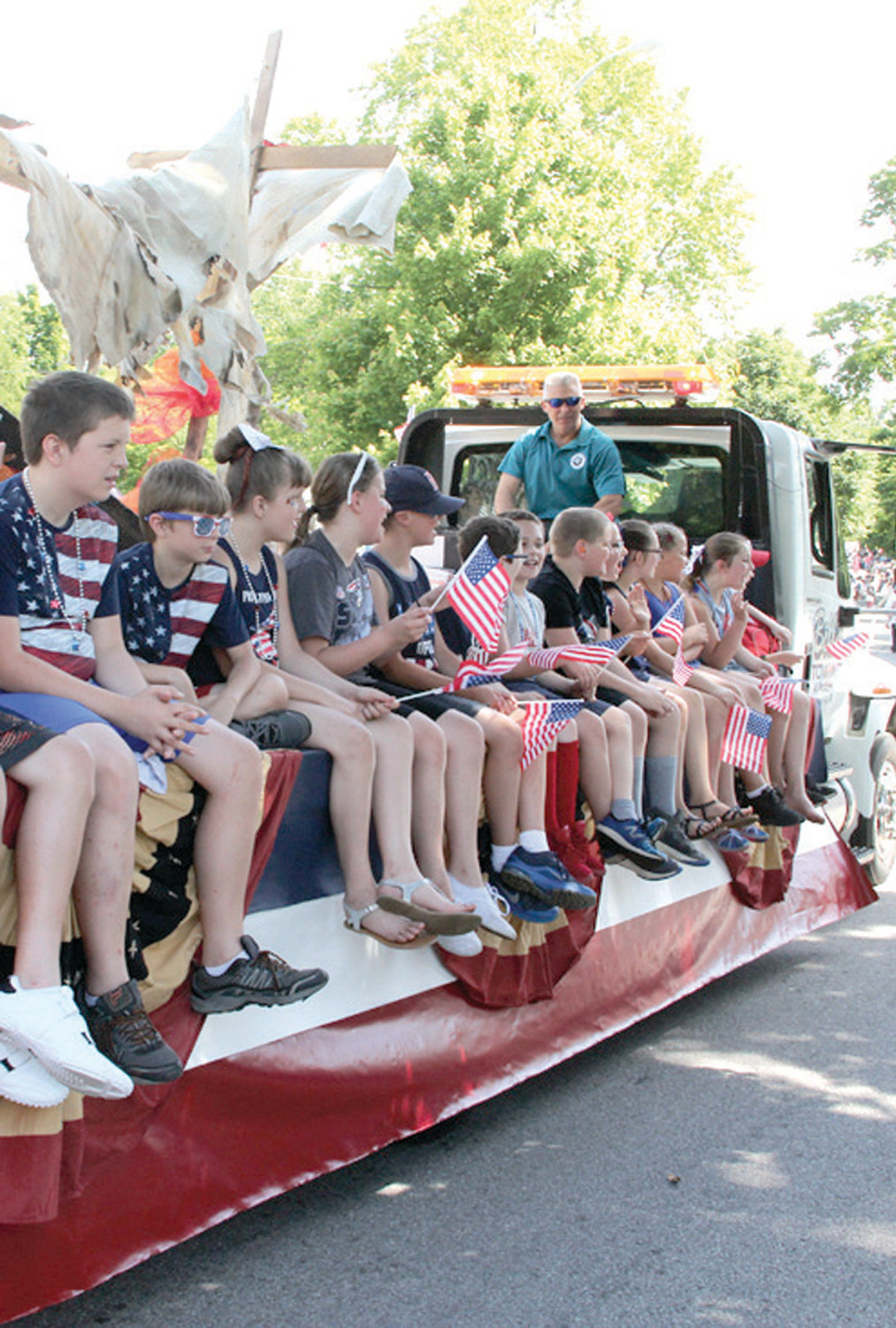 SCHOOL ON THE GO: Hoxsie School students got to experience the parade from the school float.