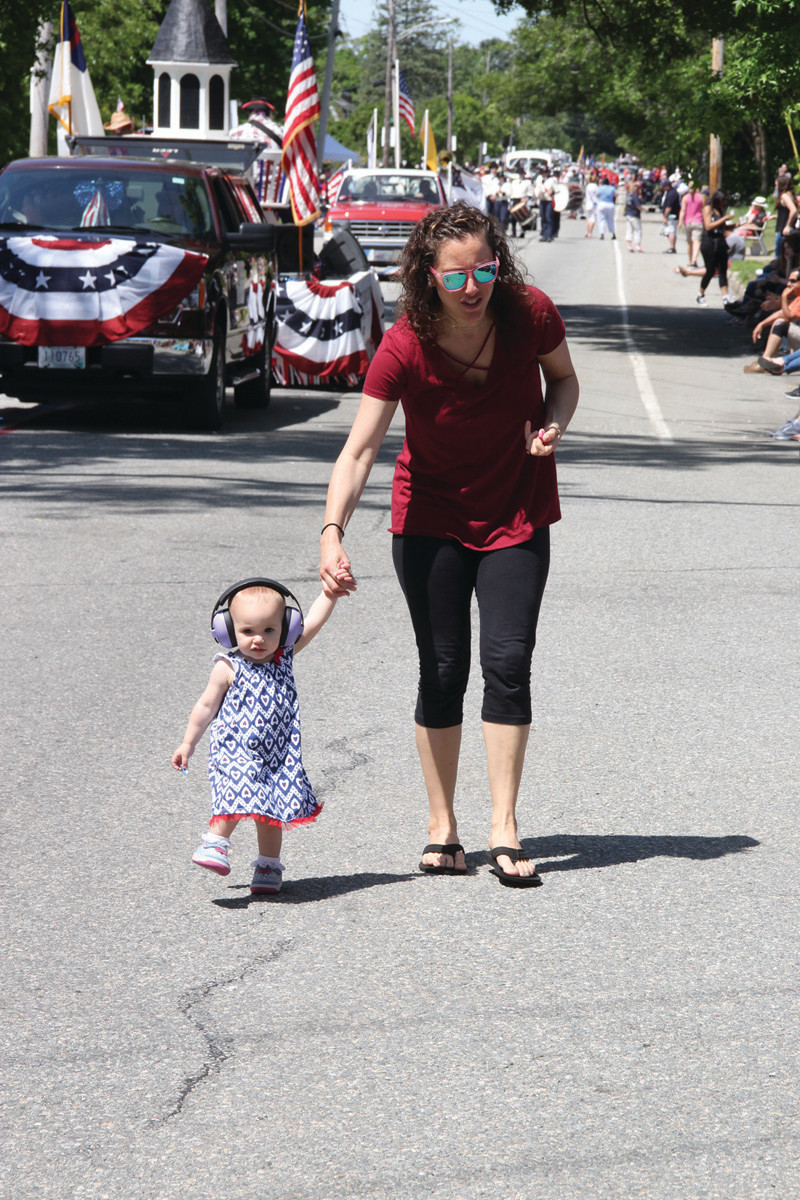 TOO YOUNG TO MARCH: Rachel Labutti had to retrieve her daughter, Emma, who was anxious to join the marchers.