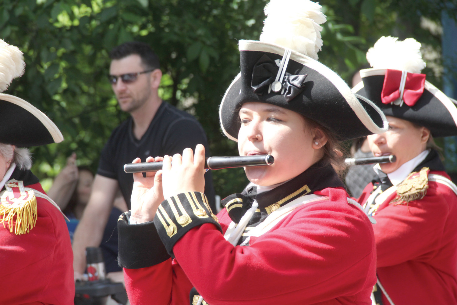 Alyssa Dubis plays with the Pawtuxet Rangers that led the parade Saturday down Narragansett Parkway to Broad Street in Cranston.