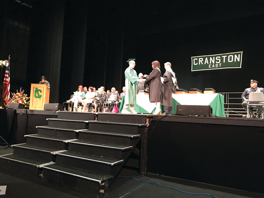 GETTING THE SHOW STARTED: The first to cross the graduation stage Anthony Adams.