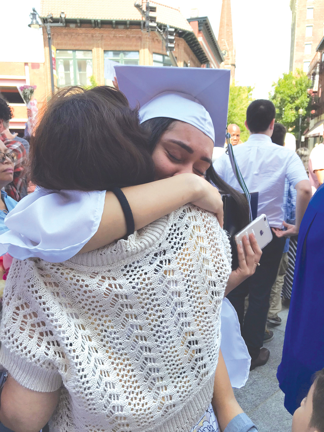 THIS IS WHAT IT IS ALL ABOUT: A recent graduate gives her grandmother a teary hug.