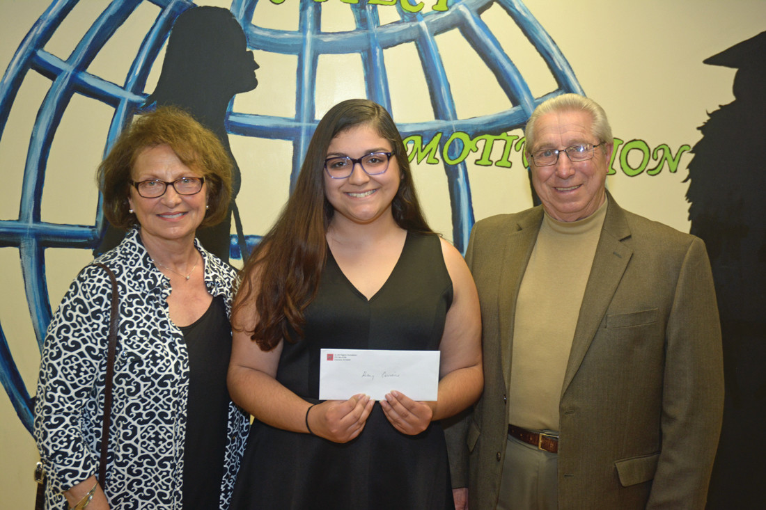 WINNER: Kelsey Carreiro (middle), winner of a $1,500 scholarship and future Rhode Island College student, poses with Rose and Anthony Pagano during the awards ceremony.