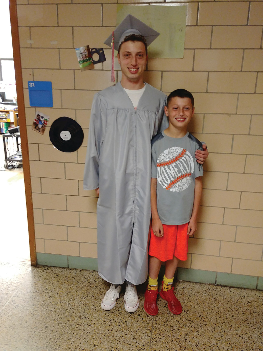 SOMEONE TO LOOK UP TO: At Woodridge Elementary, senior Jeffrey Marchetti posed with his younger brother Jake during his visit.