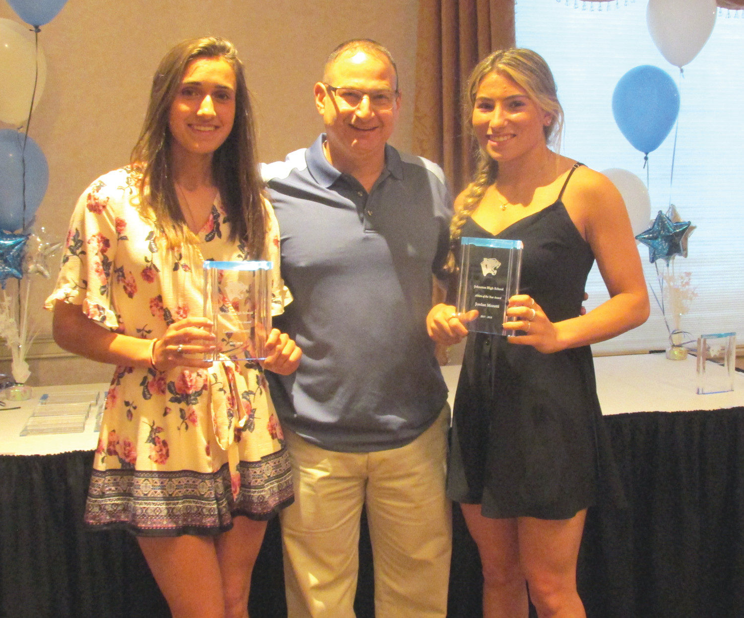 COACH'S CORNER: Chris Corsinetti, the highly-successful head girls' basketball coach at JHS, is all smiles after presenting standouts Lauren Civetti (left) and Jordan Moretti with the prestigious Co-Female Athletes of the Year Award at Monday night's special senior sendoff party. (Sun Rise photo by Pete Fontaine)