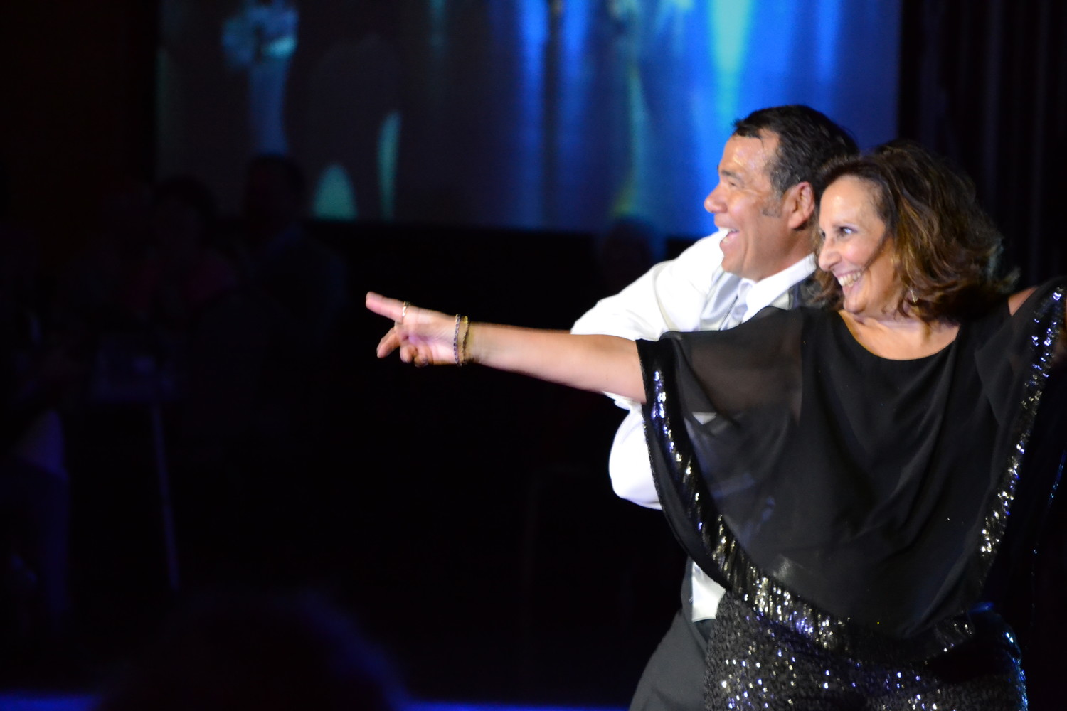 Doug Schobel of Delta Dental and Deborah O'Donnell started the show off with a pop infused, explosively energetic opening number incorporating many popular Top 40 hits spanning the decades.