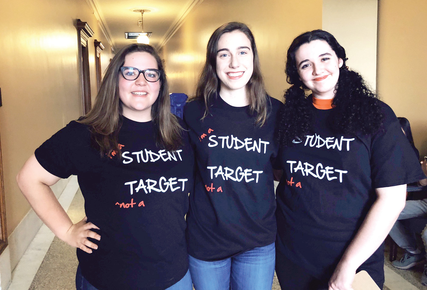 STUDENT ACTIVISTS: From left to right Sara Huckabee, Grace Reed, and Jenna Carmichael, all from Toll Gate High School, were fighting for the Safe Schools Act on Wednesday at the State House.
