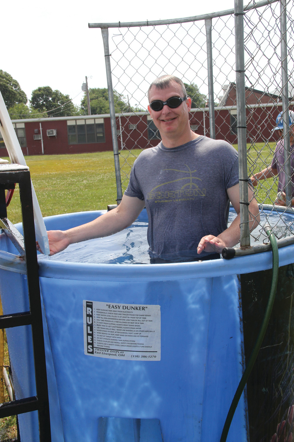 WELCOME SPLASH: Social studies teacher Peter Stone was one of eight volunteers, including the school principal, to take a turn at the dunk tank.