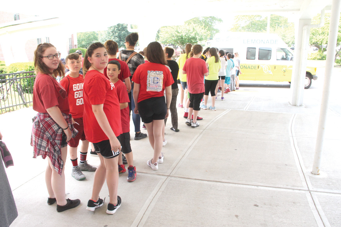 WHAT COULD BE BETTER? Vets students line up for cups of frozen lemonade that was made available by the school PTSA.