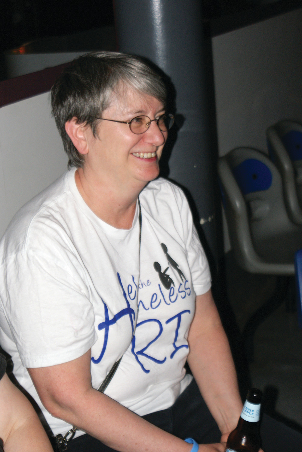 A VERY HAPPY DIRECTOR: Andrea Smith, the Director of Help the Homeless RI, smiles as bowlers raise funds to help the impoverished throughout RI at Town Hall Lanes in Johnston on June 16.