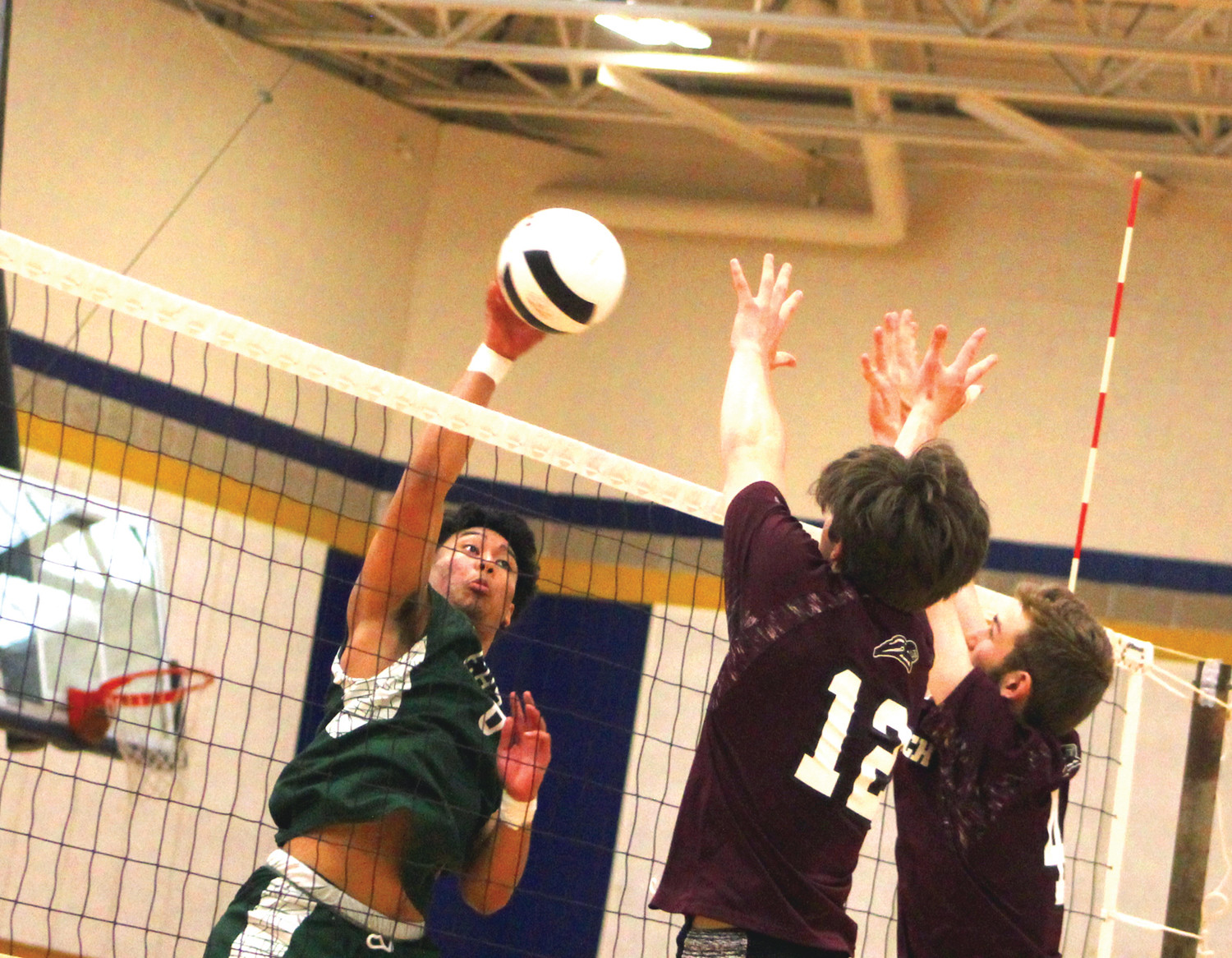 AT THE NET: Cranston East's Nick Chea attempts a spike against East Greenwich during the state title game on Saturday.