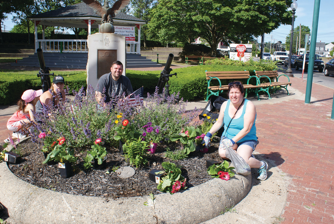 NEAR THE GAZEBO: Ward 5 City Councilman Chris Paplauskas worked along with volunteers at the garden near the Knightsville Gazebo. Pictured are (l-r) Serafina Aceto, age 6 and her mom Elisabetta, Chris Paplauskas and Amy Ricci.