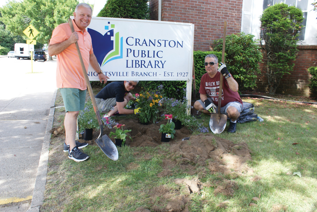 NEW FLOWER BED: During the Beautification Project in Ward 5, volunteers dug and planted a new flower bed at the Cranston Library Knightsville Branch. Pictured working on the garden are (l-r) Jeffrey Barone (Executive Director, Cranston Senior Services), Anna Saccoccio and Ed Garcia (Director of Cranston Public Libraries).