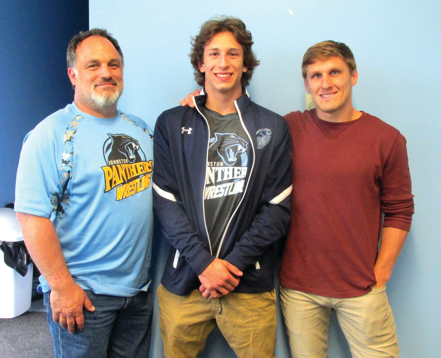 PROUD PANTHER: James Baccala III (center) is joined by his father James Baccala Jr. (left) and RI Wrestling USA Chairman Steven Keith who recently presented the one-time JHS Panther wrestling team captain the Rico Lomastro Scholarship.