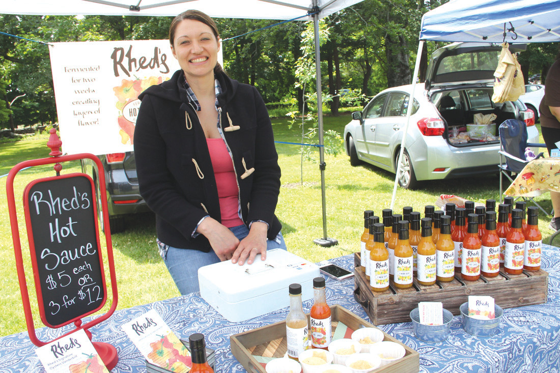 HOT STUFF: When Deja Hart moved here from California she grew peppers. It wasn't long before she transitioned to making a uniquely Rhody hot sauce and starting her company, Rhed's Fermented Hot Sauce.