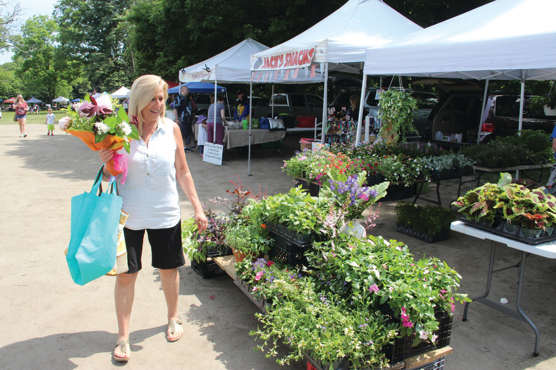 MARKET IN BLOOM: Cindy Kelly of East Greenwich found the perfect bouquet at the Goddard market.