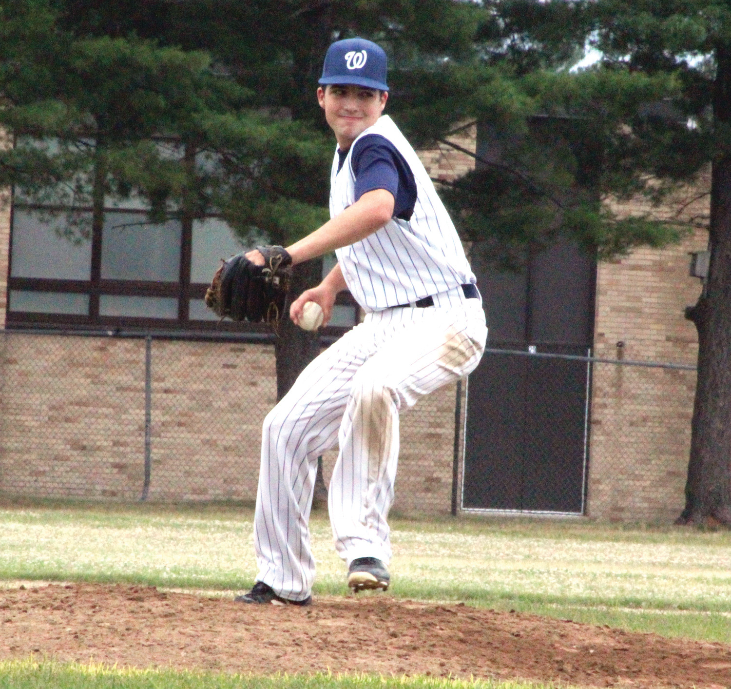 ON THE HILL: Warwick PAL's Cam Armenti delivers a pitch.