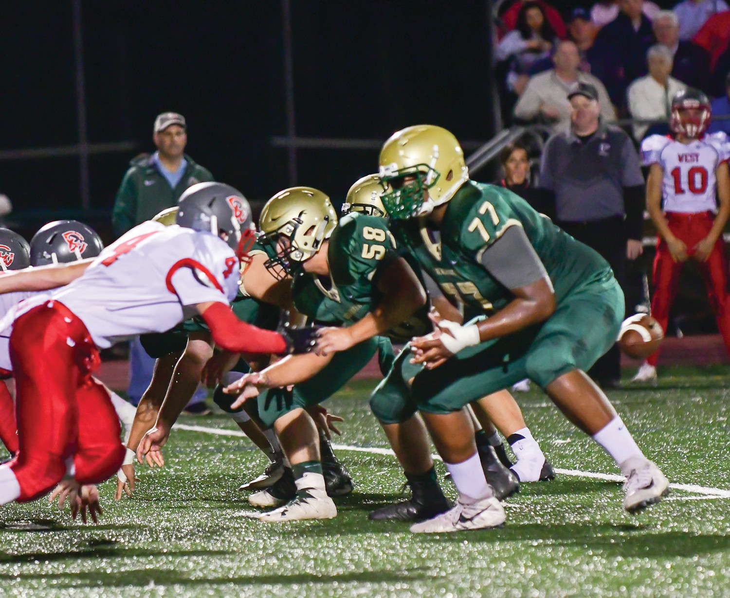 BLIND SIDE: Bishop Hendricken's Xavier Truss blocks during the 2017 season.