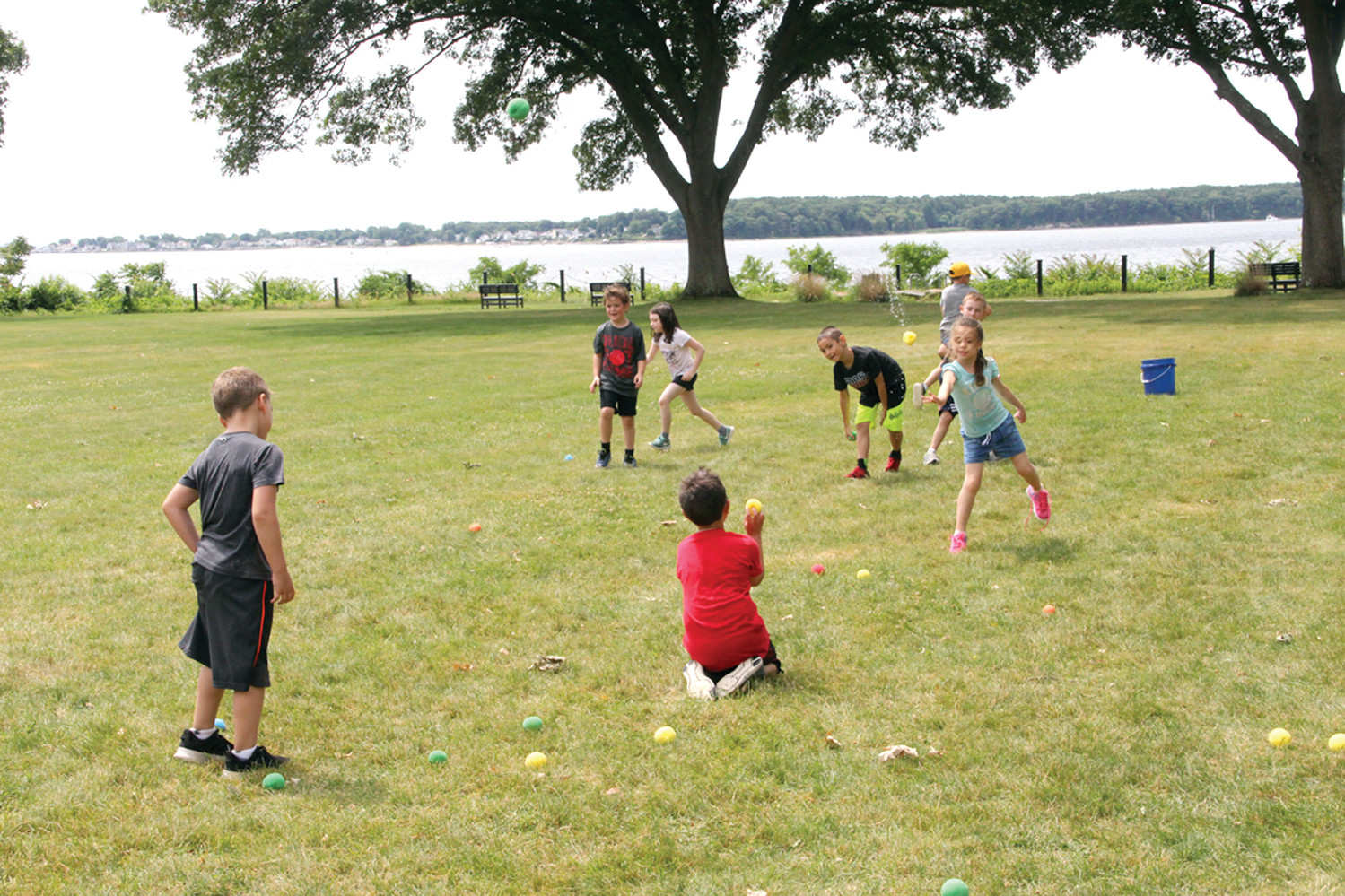 WATER FUN: At the H2O station, campers play a game by flinging sponge balls soaked in water.
