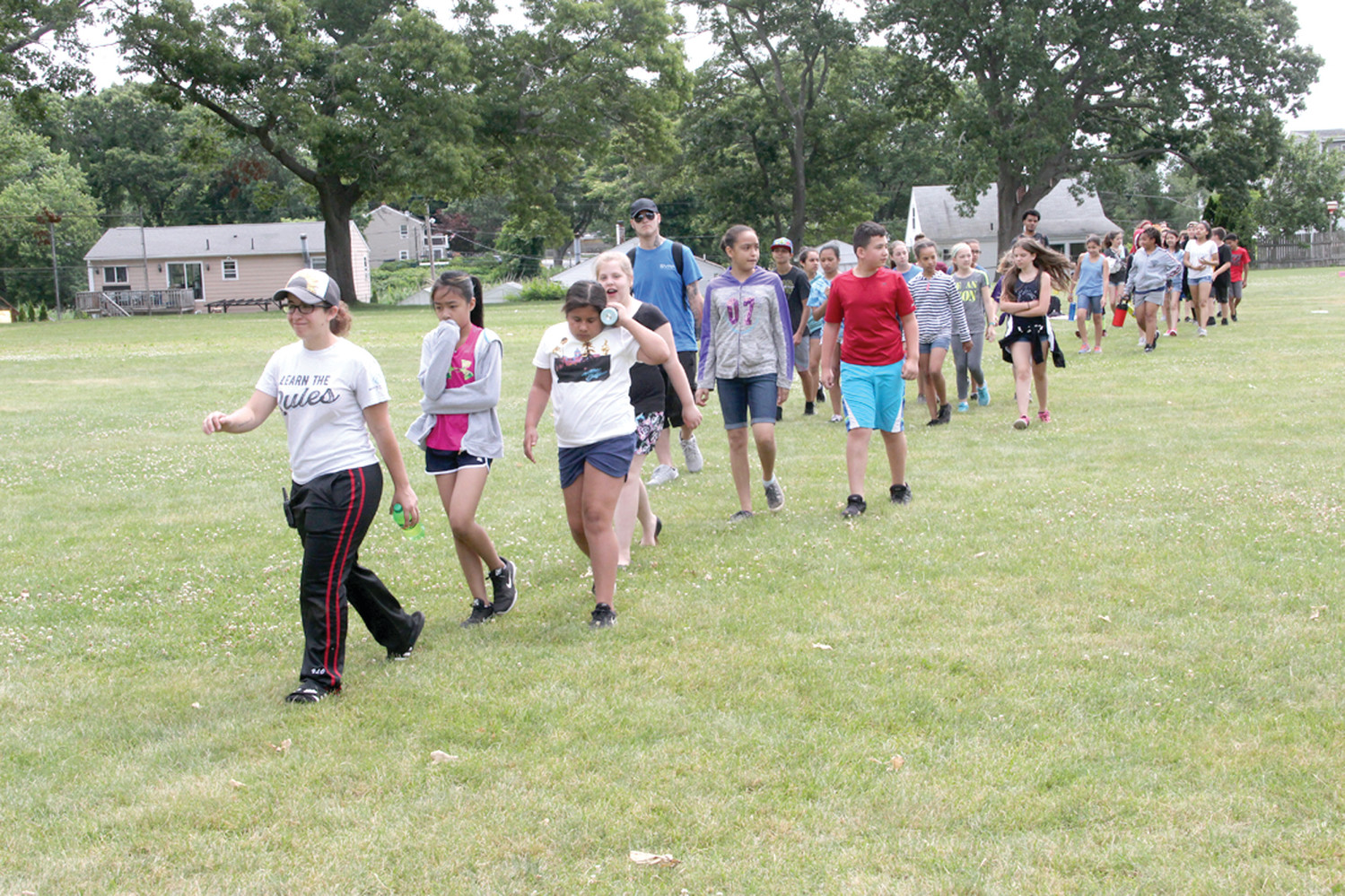 FOLLOW THE LEADER: Camp counselors guide their assigned campers to their next activity once the schedule rotates.