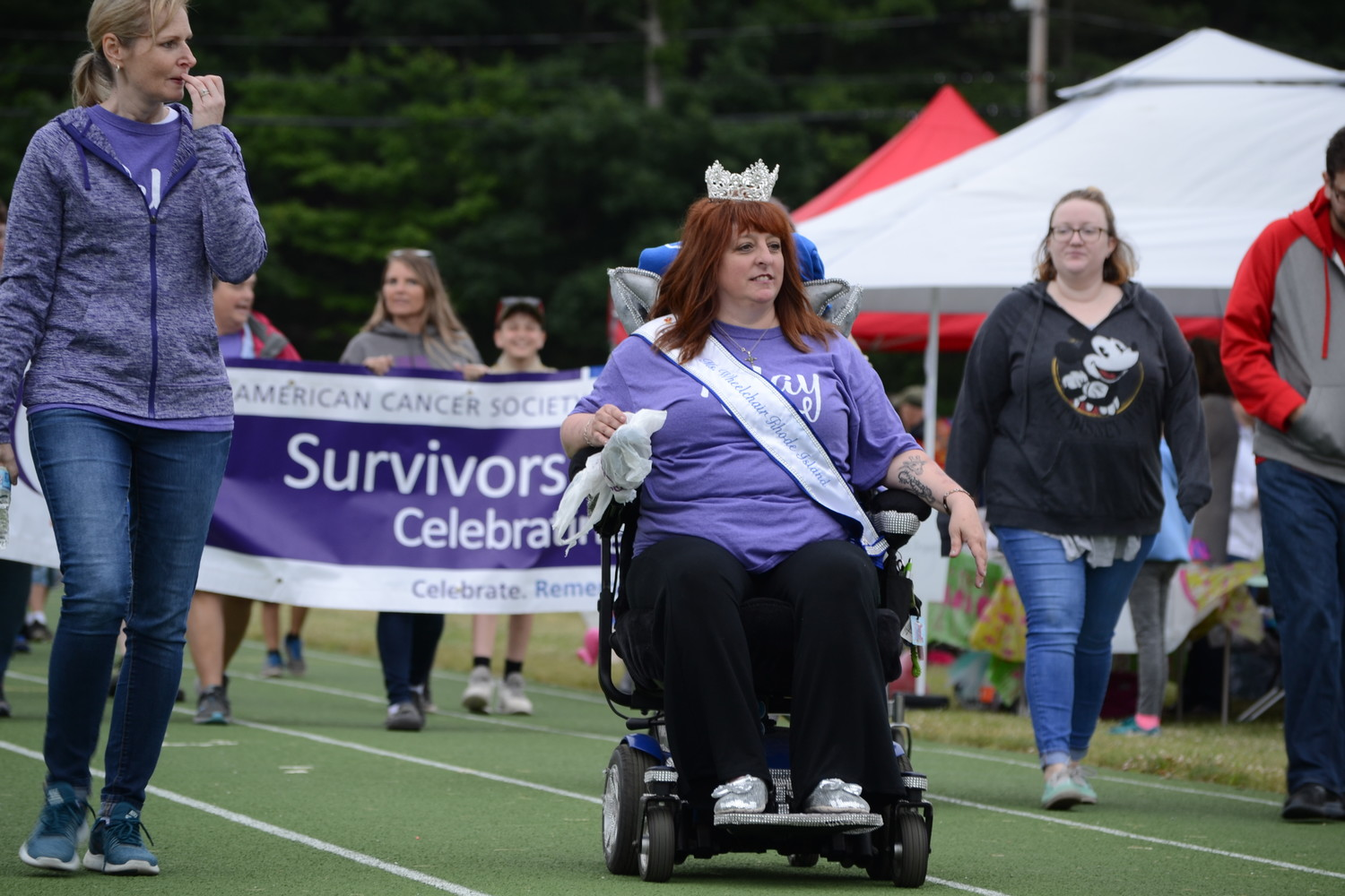 LEADING THE CHARGE: Pedersen, who has survived multiple bouts of both breast and bladder cancer, in addition to being paralyzed below the waist, led the survivor's lap during the Northern Rhode Island Relay for Life in Smithfield last Saturday.