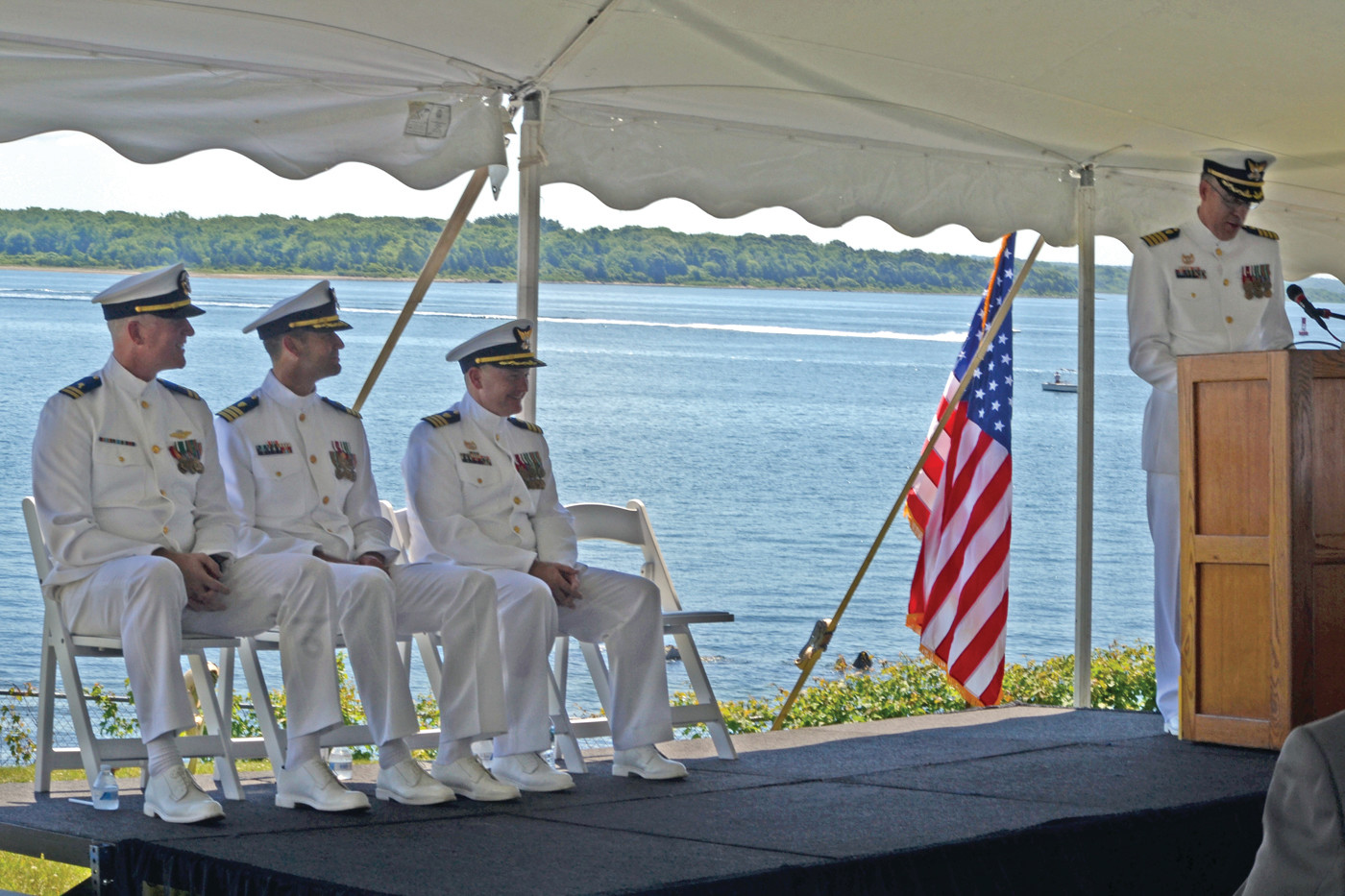 ON THE WATERFRONT: United States Coast Guard officers gathered at Warwick Neck Lighthouse on a picturesque Friday morning for a Change of Command ceremony.