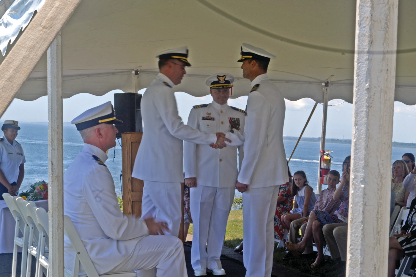 CHANGE OF ORDERS: Captain Andrew Brown watches on as new Commander of CEU Providence, Joshua Fant, receives his orders from Captain T. Wade Gesele, Commander of the Shore Infrastructure Logistics Center for the U.S. Coast Guard.