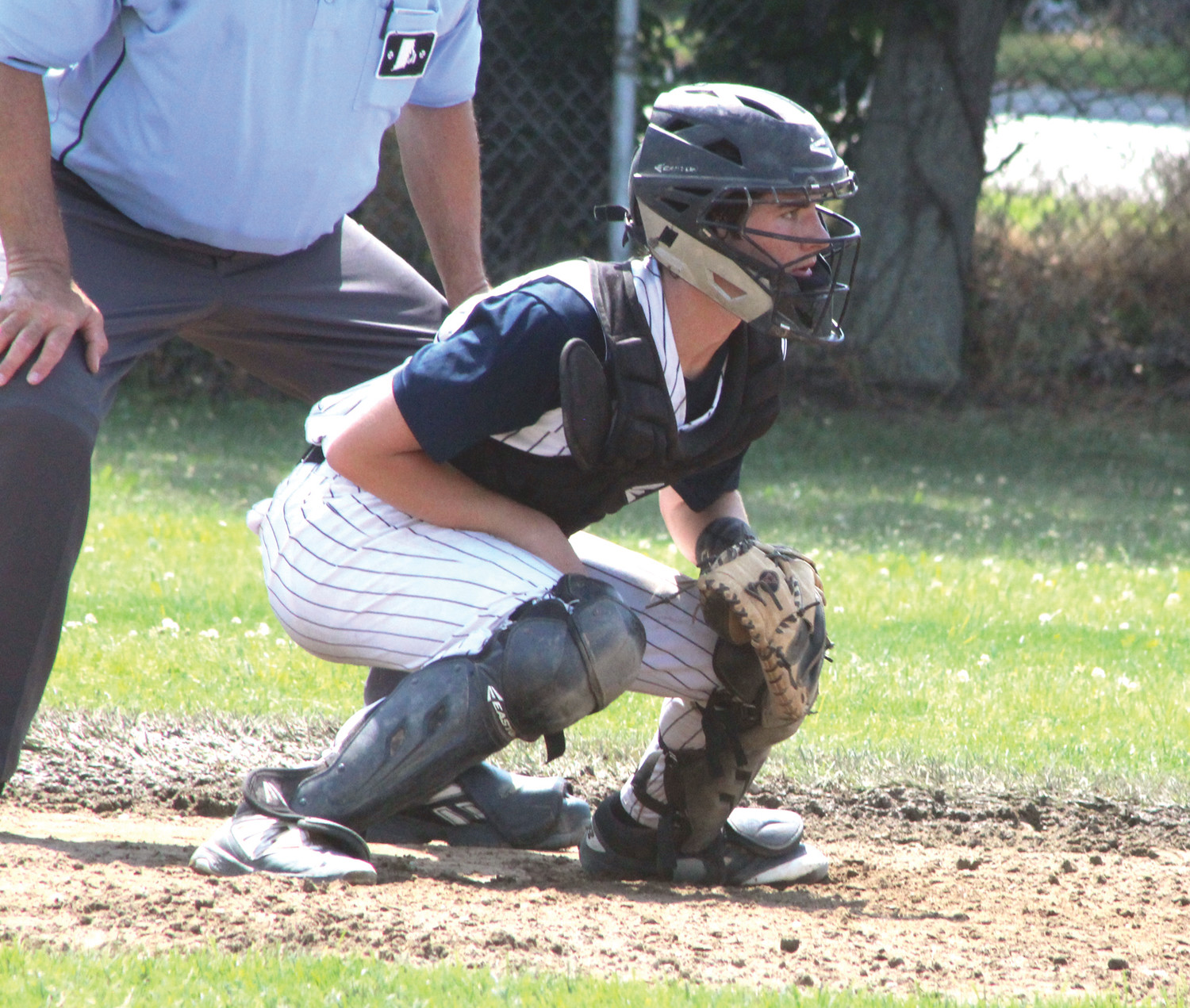 Catcher Jeremiah Mullane throws down a sign.
